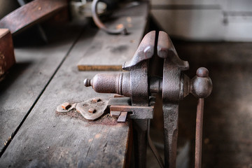 Vintage tools on a bench lit by a window, vice, gunsmith, gun, smith, blacksmith, classic, rusty, colonial era