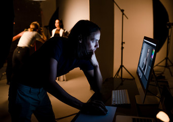 Wall Mural - Art director checking photos on a monitor