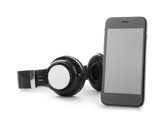 Smartphone with blank screen and headphones on white background