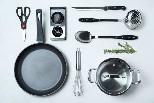 Flat lay composition with clean cookware on light background