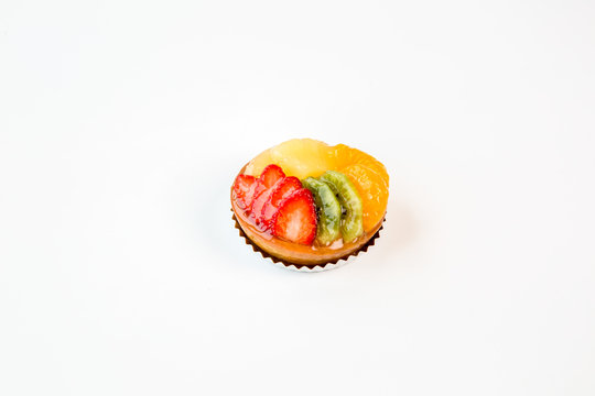 small fruit cake on a white background
