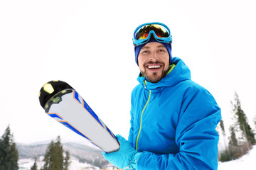 Male skier on slope at resort. Winter vacation