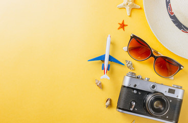 Flat lay traveler accessories on yellow background