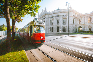 Vienna tram with Burgtheater at sunrise, Vienna, Austria