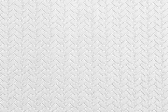 Textured white leather background with wickerwork cable pattern