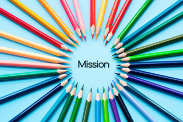 Mission concept, group of color pencils share idea to complete mission