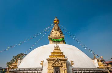 The white dome and gilded spire of Swayambhunath Stupa, Kathmandu, Nepal.