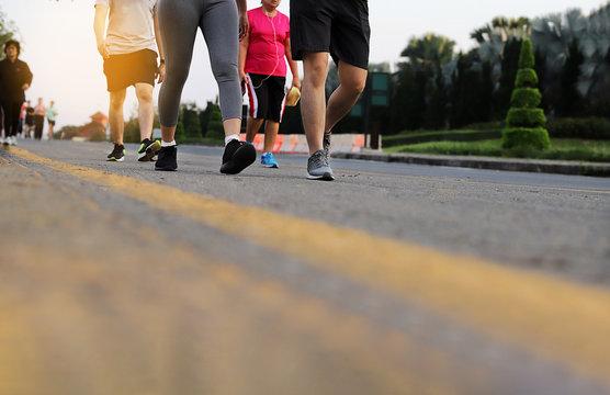 Group Senior people  legs walking exercise at public park . selective focus - Image