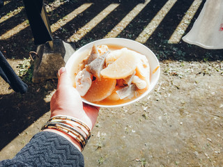 hygge : eat lunch at home in Japan.man holding Oden(kind of Japanese stew)