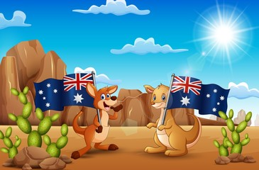 Happy Australia Day with kangaroos holding a flag in the desert