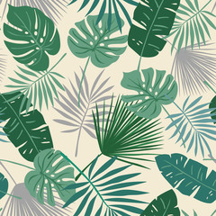 Tropical seamless repeat pattern with green leaves of different shapes on cream background