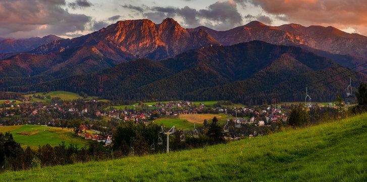 Tatra Mountains and Zakopane town in the last rays of the setting sun.Panorama.Tatra mountain,Poland