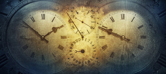 The dials of the old antique classic clocks on a vintage paper background. Concept of time, history, science, memory, information. Retro style. Vintage clockwork background.