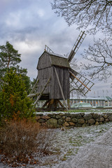 An old wooden windmill during winter. Stockholm, Sweden.