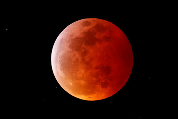 A total lunar eclipse that is called a 'Super Blood Wolf Moon' is seen from Encinitas, California