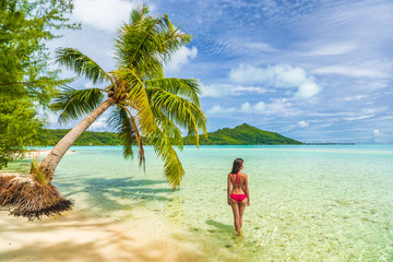 Wall Mural - Vacation Luxury Travel woman walking on Tahiti paradise motu beach Bora Bora