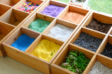 art hobby texture of colored sand in box