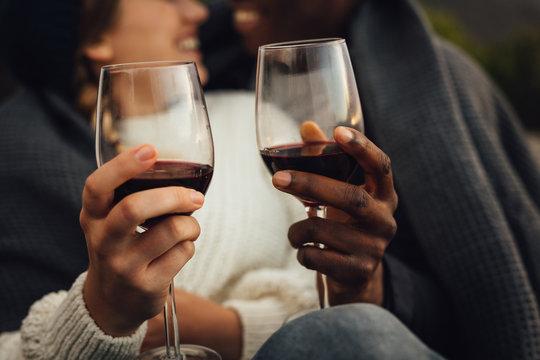 Couple having wine on picnic