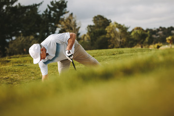 Senior golfer playing on the golf course