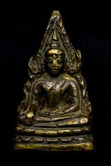 Old Buddha amulet.