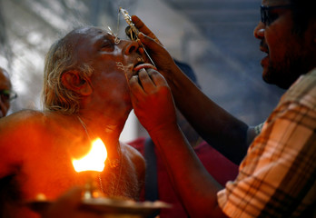 A devotee has his tongue pierced during the Thaipusam festival in Singapore
