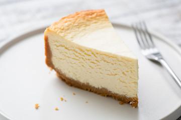 New York Cheesecake Slice On Plate. Closeup view. Tasty smooth cheesecake