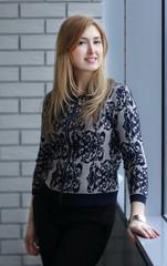 business woman standing near window in office
