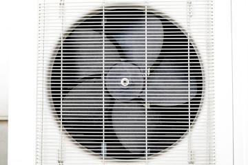 Fan Condenser unit coil fan of air conditioner close up.