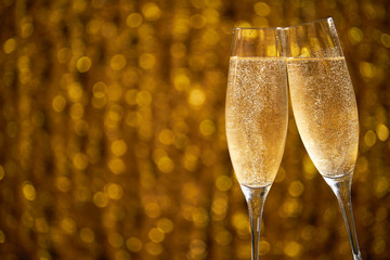 Two glasses of champagne on shiny bokeh effects for a wedding