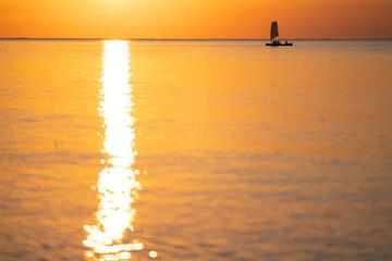 (石垣島)夕焼けの海と船