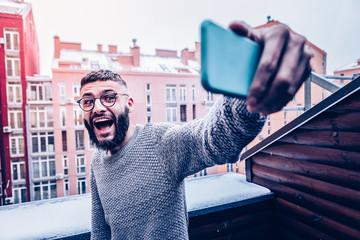 Happy nice man posing for a selfie