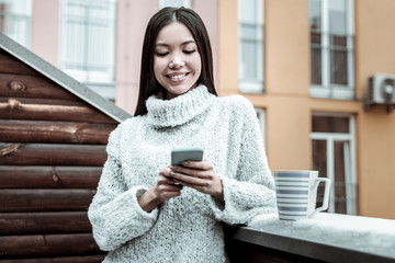 Nice happy woman using her new smartphone