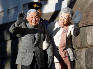 Japan's Emperor Akihito and Empress Michiko stroll on a beach near their imperial villa where they are staying for the emperor's recuperation in Hayama town