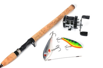 jerkeys spinning and multiplier reel for fishing on a white background close-up