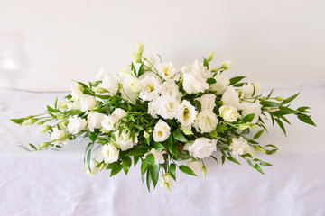 floral arrangement for interior decoration, table setting for a wedding or to create a home cosiness. use as background. white flowers bells