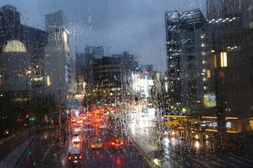 Rainy evening in the city. Raindrops on glass
