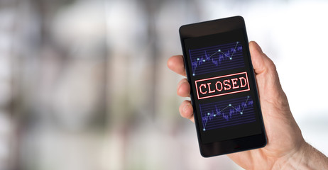 Closed stock market concept on a smartphone