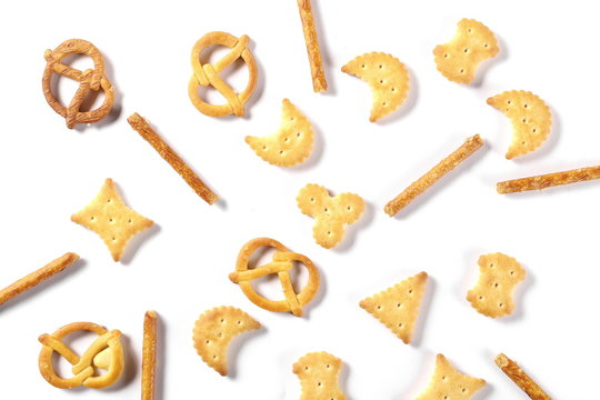 Salty cracker pretzel party mix isolated on white background, top view