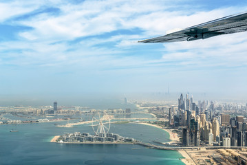 Aerial view of Dubai Marina skyline with Dubai Eye ferris wheel, United Arab Emirates
