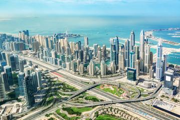 Wall Mural - Aerial view of Dubai Marina skyline and road interchange, United Arab Emirates