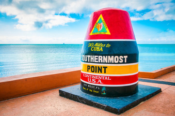 Empty scenic view of the colorful concrete buoy marking the southernmost point of the continental USA in Key West, Florida