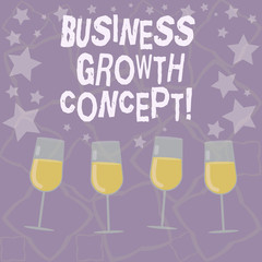 Writing note showing Business Growth Concept. Business photo showcasing process of improving some measure of success Filled Cocktail Wine Glasses with Scattered Stars as Confetti Stemware