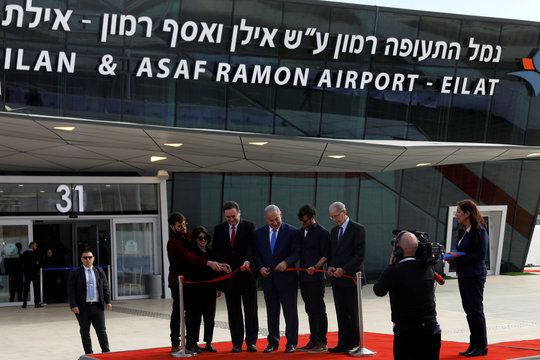 Israeli Prime Minister Benjamin Netanyahu and Israeli Intelligence and Transportation Minister Katz cut a red ribbon during the inauguration ceremony of the Ramon International Airport just outside the southern Red Sea resort city of Eilat, Israel