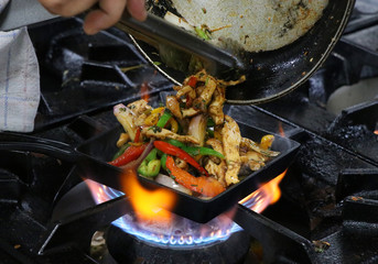mexican fajitas on sizzling plate