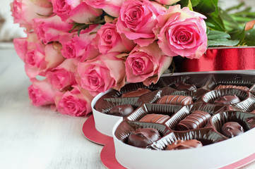 Beautiful Soft Pink Roses with a Heart Shape Box of Chocolate Candy