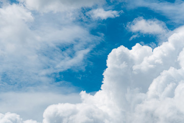 Blue sky and white cumulus clouds on sunny day. Fluffy white clouds and sky abstract texture background. Cloudy sky. Cloudscape. Nature background.
