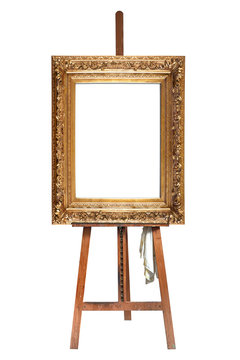 Painter's easel and empty antique golden frame