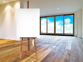 Painter's easel and empty canvas in a modern interior