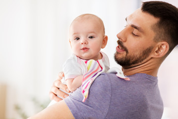family, parenthood and people concept - father with little baby girl at home