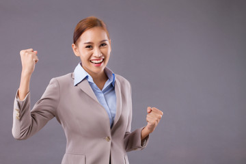 excited laughing asian businesswoman looking with surprise; portrait of happy positive surprised excited asian business woman laughs and looks at you; Southeast tan skin asian young adult woman model